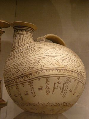 Daunian pottery - Terracotta askos (flask with a spout and handle over the top) Native Italic Daunian Canosan 330-300 BCE
