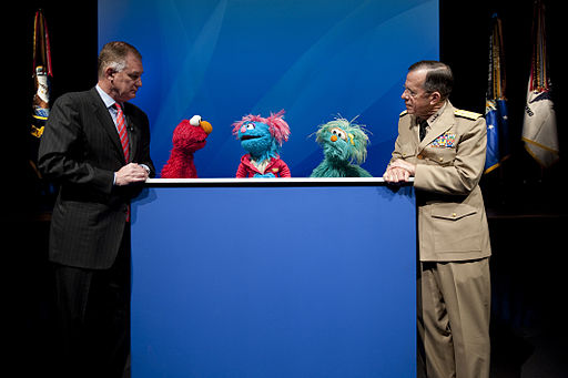 Defense.gov News Photo 100413-N-0696M-241 - Deputy Secretary of Defense William J. Lynn Chairman of the Joint Chiefs of Staff Adm. Mike Mullen and the Sesame Street Muppets Elmo Jesse and