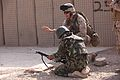 Defense.gov News Photo 110712-M-KL854-047 - U.S. Marine Staff Sgt. Brian Zeifang right with Combat Logistics Battalion 7 2nd Marine Logistics Group coaches an Afghan National army soldier.jpg