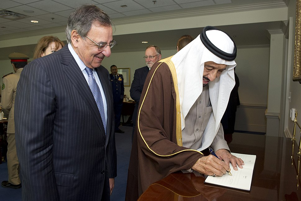 Defense.gov News Photo 120411-D-BW835-023 - Secretary of Defense Leon E. Panetta stands with Saudi Arabian Minister of Defense Prince Salman bin Abd al-Aziz Al Saud as he signs the guest book