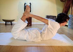 Yoga postures dhanurasana