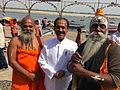 Dr Pankaj Naram Swami Omcar and Baba at Ganga River.jpg