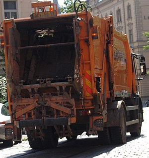 Waste collector - Waste collection vehicle operating in the streets of Prague