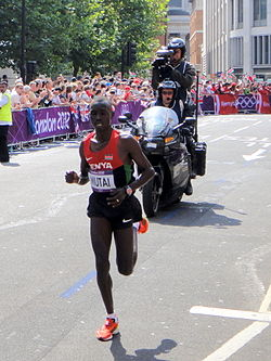 Emmanuel Kipchirchir Mutai (Kenya) and camera motorbike - London 2012 Mens Marathon.jpg