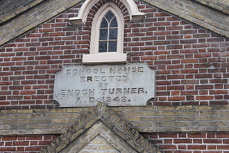 Enoch Turner School - The date stone was installed during construction of the Schoolhouse in 1848, engraved with founder Enoch Turner's name and the year of completion.
