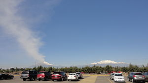Puebla International Airport - Parking lot and Popocatepetl volcano and Iztaccihuatl mountain.