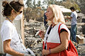 FEMA - 33424 - A Red Cross volunteer talks to the sister a fire victim in California.jpg