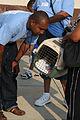 FEMA - 37722 - Volunteer comforts a dog being evacuated in Louisiana.jpg