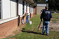 FEMA - 42275 - FEMA Videographer with School Employee at Damaged School.jpg