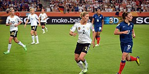 Gaëtane Thiney - Gaëtane Thiney, in blue, and Bianca Schmidt in the France-Germany match at the 2011 FIFA Women's World Cup