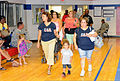 Family members arrive to the West Fort Hood Physical Fitness Center to see off the deploying Soldiers with the 418th Transportation Company, 553rd Combat Sustainment Support Battalion, 4th Sustainment Brigade 130610-A-JI408-005.jpg