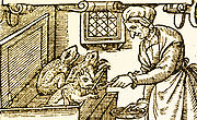 Old woodcut showing woman feeding imps