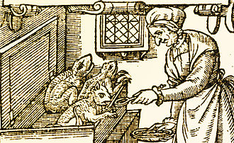 Imp - Old woodcut depicting a woman feeding imps