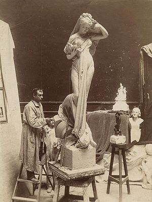 Fernando Miranda y Casellas - Fernando Miranda in his studio with his model of The Spirit of Research (c. 1897). His Bust of Columbus is at far right.