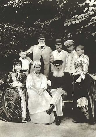 Afanasy Fet - Yakov Polonsky (standing, second from the left) and members of his family guesting at Vorobyovka in 1890. Sitting, left to right: Maria Botkina, Natalya (Polonsky's daughter) and Afanasy Fet