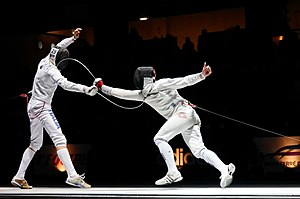 Épée - Electric épée fencing: Diego Confalonieri (left) and Fabian Kauter in the final of the Trophée Monal