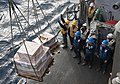 Flickr - Official U.S. Navy Imagery - Sailors guide a pallet into place on the deck..jpg