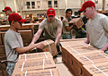 Flickr - The U.S. Army - Parachute riggers prep supplies for Operation Unified Response in Haiti.jpg