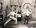 Footlights-1921-Elsie Ferguson fencing with director Robertson.jpg