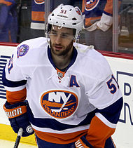 "Frans Nielsen wearing a white Islanders away jersey with an assistant captain ""A"" on it, wearing a white helmet"