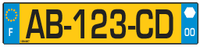French vehicle registration plate with local reference(from 2008): there will be a regional logo inside the white hexagon, and the number of the departement below it.