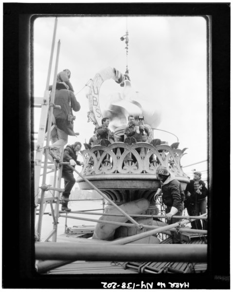 File:French metalworking crew standing on balcony celebrating the new flame and balustrade being in place, November 25, 1985 - Statue of Liberty, Liberty Island, Manhattan, New York, HAER NY,31-NEYO,89-202.tif
