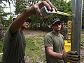 From left to right, U.S. Marine Corps Cpl. Otis M. Peshlakai, a water purification specialist, and Lance Cpl. Glenn Mosley, a refrigeration mechanic, both with 8th Engineer Support Battalion, Logistics Combat 100823-M-PC721-596.jpg