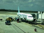 Frontier Airlines Airbus A319 (Gate C23, Terminal 3, Cancún International Airport's new Terminal 3 - March 2008).jpg