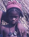 Fula (Peul) girl at a small settlement on the road to Bafodia, Sierra Leone (West Africa) (2034126943).jpg