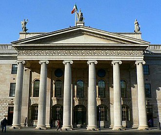 General Post Office, Dublin - The Greek hexastyle portico of the General Post Office, completed in 1818. The Royal Coat of Arms, similar to those at King's Inns and the Irish Houses of Parliament, was removed after independence.