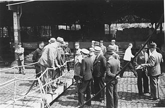 MS St. Louis - St. Louis Captain Gustav Schröder negotiates landing permits for the passengers with Belgian officials in the Port of Antwerp.