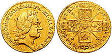 A 1718 quarter-guinea coin from the reign of George I, showing him in profile.