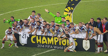 The German national football team after winning the FIFA World Cup for the fourth time in 2014. Football is the most popular sport in Germany. Germany champions 2014 FIFA World Cup.jpg