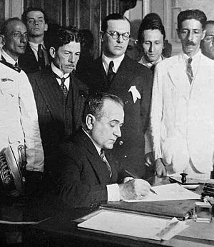 Getúlio Vargas - Vargas appointing his ministers on November 3, 1930. The man with glasses (center) is Lindolfo Collor, maternal grandfather of Fernando Collor de Mello, the future President of Brazil.