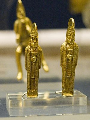 Oxus Treasure - Gold statuettes carrying barsoms, with a rider behind