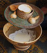 Gourds - communal serving millet porridge with calabash bowls, spoons, uncovered.jpg