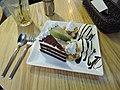 Green tea cheesecake and chestnut chocolate cake with ice cream.jpg
