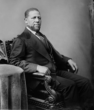 1870 in the United States - February 25: Hiram Rhodes Revels, the first African American Congressman.