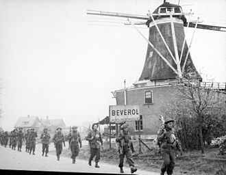 II Canadian Corps - II Canadian Corps troops of the Régiment de Maisonneuve advancing along the road from Holten to Rijssen, the Netherlands, April 9, 1945.