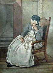 Woman in an armchair.
