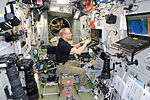 ISS-47 Tim Kopra on a Laptop in the Zvezda Service Module.jpg