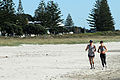 Ian and Susan jogging on Maunganui beach 2 (5643933835).jpg