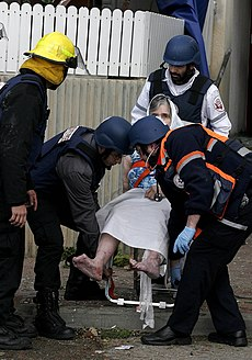 Injured elderly Israeli woman after rocket attack from Gaza hit civilian area in Israel.jpg
