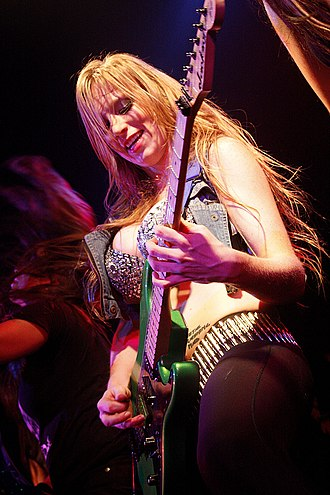 Courtney Cox (musician) - Courtney Cox, lead guitarist of The Iron Maidens