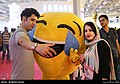 Islamic man and woman at an an electronic exhibition in Tehran (Iran).jpg