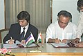 Jairam Ramesh and the Minister of Foreign Economic Relations, Investment and Trade of the Republic of Uzbekistan, Mr. Alisher Shaykhov signing the Protocol of the Sixth Session of the Inter-Governmental Commission on Trade.jpg