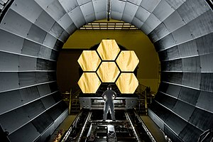 Primary mirror - Six of the primary mirrors of the James Webb Space Telescope being prepared for acceptance testing
