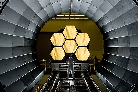 """""""NASA engineer Ernie Wright looks on as the first six flight ready James Webb Space Telescope's primary mirror segments are (prepared) to begin final cryogenic testing at NASA's Marshall Space Flight Center."""""""