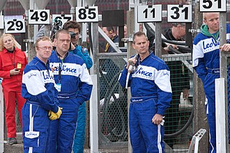 TT Grandstand - Former racer James Whitham (centre right with nozzle over his shoulder) when part of a TT refuelling crew in 2012