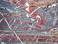 Jaspilite banded iron formation (Soudan Iron-Formation, Neoarchean, ~2.69 Ga; Stuntz Bay Road outcrop, Soudan Underground State Park, Soudan, Minnesota, USA) 37 (18603187664).jpg